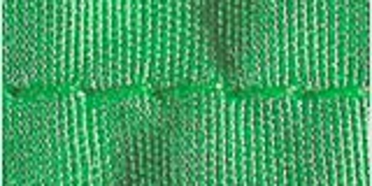 Close-up of a seam on a green woven fabric that shows seam puckering