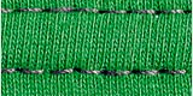 Close-up of a seam on a green knitwear that doesn't show any problems