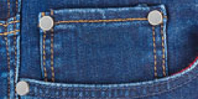 Close-up of a jeans pocket with rivets