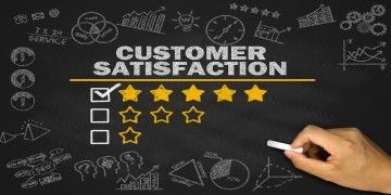 Black picture showing the words Customer satisfaction and stars