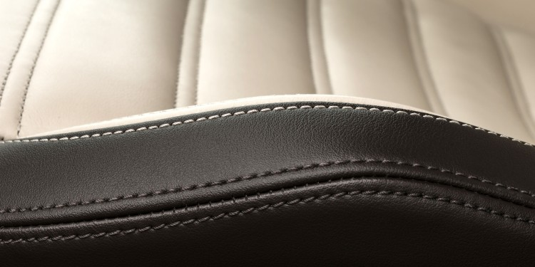 Close-up of seam on a car seat with black and white leather