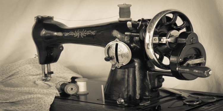 Ancient sewing machine with mechanical drive system