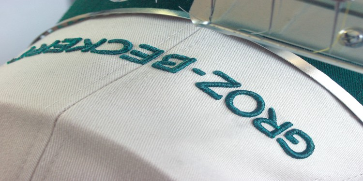 White cap with the Groz-Beckert logo embroidered on it