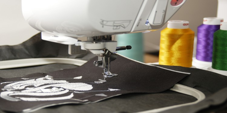 Embroidery machines that creates a white pattern on a black fabric