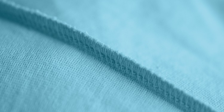 Close-up of an overlock seam on a blue fabric