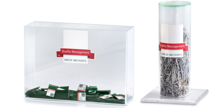 Two collection bins made from acryl, one in square format and one in cylindrical format